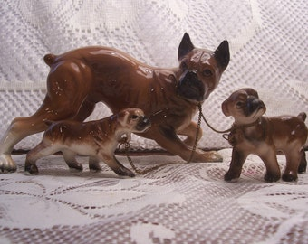 Boxer and Two Puppies on a Chain Figurine, Japan