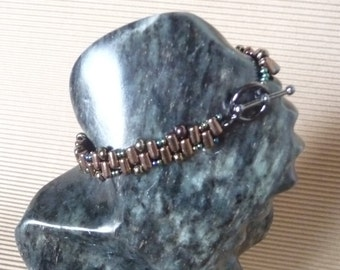 Bronze rockeries and iridescent blue bracelet