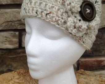 Crocheted ear warmer headband with flower/button