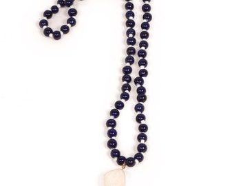 Long navy necklace with hassle and white accents