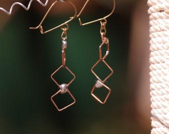 Delicate copper tin-welded earrings