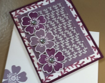 Purple all-occasion greeting card with floral and vine design elements