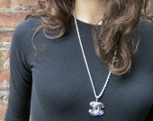 Chanel Quilted logo pendant with  chain, CC logo. silver tone. Chanel necklace