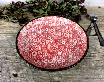 Handmade red ceramic plate with Q's