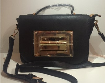 Ladies leather shoulder/clutch bag