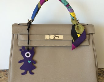 Leather Monster Bag Charm on Silk Cord