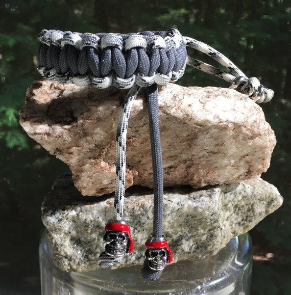 Paracord Anklet or Bracelet, completely adjustable and reversible, 2 silver & red pirate beads, 2 chrome beads