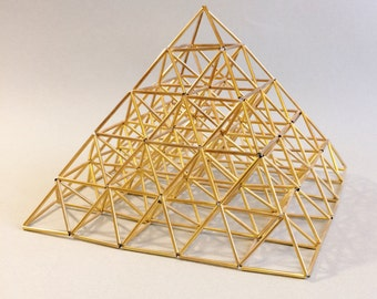 Small golden pyramid sculpture