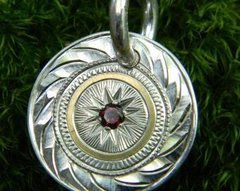"Hand Engraved ""Starburst"" Sterling Silver Pendant with 24 Karat Gold and Garnet"