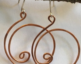 hammered copper and sterling silver hoops with a swirl