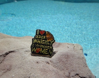 I love older whisky and younger women hat pin lapel pin honky tonk bar pin 1980s lapel pin bar pin back