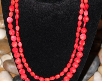 Double stranded red beaded necklace