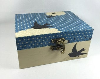Wood bird box box in blue sky - off-white and blue