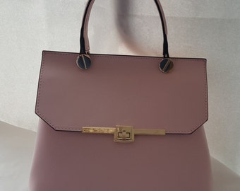 Pink leather bag with strap