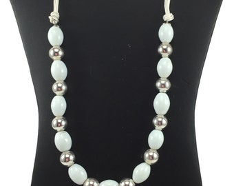 white and silver necklace and earrings set