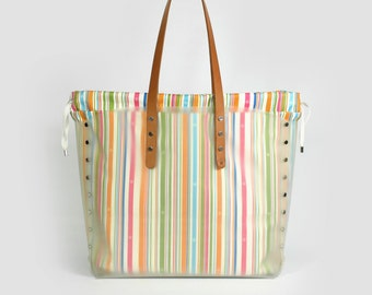 White big shopper with multicolor striped bag