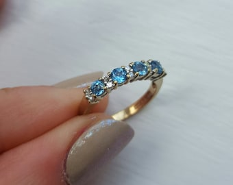Unique Pale Blue Sapphire and Diamond 9ct gold half eternity engagement ring