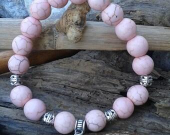 62) Bracelet en turquoise rose avec breloque argenté  coeur