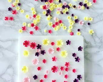 Handmade tiny assorted sugar blossoms cake decoration