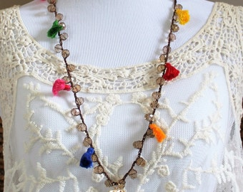Crystal necklace  with tassel and  gold field pendant .