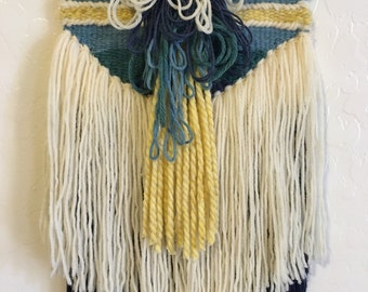 Colorful and quirky woven wallhanging