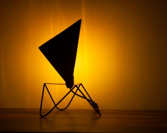 Table lamp with a triangular shade for indirect ambiant lighting