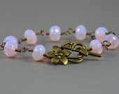 Bracelet Featuring Luminous Pink Opalite Faceted Glass and Antiqued Brass Flower Toggle Clasp