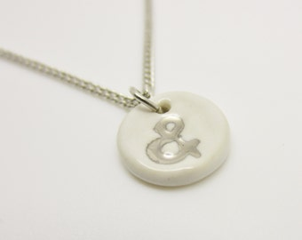 Metallic Silver Small Ampersand Stamped Necklace Glazed Ceramic Porcelain on an 18 inch Gold Chain