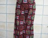70s hip huggers, booty lovin' low cut wide leg pants. Early 70s regal wall paper print on cotton. Size S.