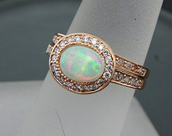 AAAA Australian Opal   7.5x5.8mm  0.53 Carats   Oval 14K Rose gold Halo bridal set with .35cts of diamonds. 777