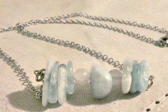 This aquamarine pi necklace would be perfect for STEM and sciart nerds.