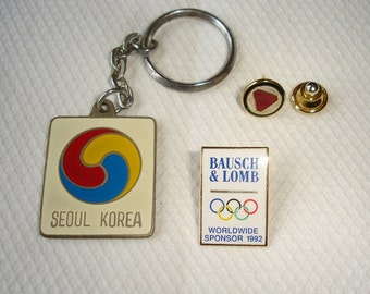 2 Bausch & Lomb Tie Pins, Seoul Korea Key Ring, B L Worldwide Olympic Sponsor 1992Bausch and Lomb Logo