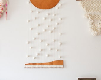 Wall hanging - leather and clay - down up - by Soledad Proaño