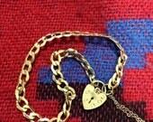 60% Off Blowout Sale. Antique 9k Solid Gold Padlock Locket Bracelet. Good condition.