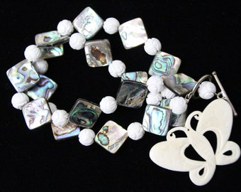 Hand Carved White Onyx Gemstone Ball with Abalone Paua Shell and Carved Bone Butterfly Pendant Necklace