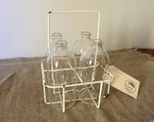 Fabulous VINTAGE Four hole white wire coated milk carrier / tray / crate including four upcycled milk bottles. Industrial decor. 1960's.