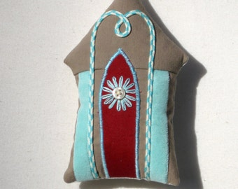 Little embroidered gingerbread house ornament with velvet ribbon