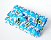 Woman's blue and pink aztec coin change travel purse wallet pouch modern shapes with bow.