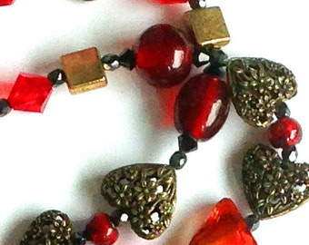"Handmade 33"" BLOOD RED Bohemian Faceted and Foiled Art Glass Necklace Antique Gold and Filigreed Hearts Accent Beads"