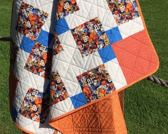 """A 39.75"""" X 47.75"""" Orange and Blue Basketball Themed Quilt"""