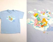 80s CARE BEARS Baby Blue Teddy Bear Cartoon Rainbow Cloud Picnic Vintage Short Sleeve Cotton Tee T Shirt / Fits Womens Small , Youth XL