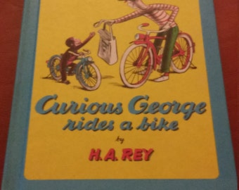 Vintage 1973 Curious George rides a bike book hardcover HC H.A. Rey