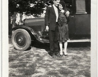Old Photo Affectionate Couple by Car Photographers Shadow 1920s Photograph snapshot Vintage Woman Man
