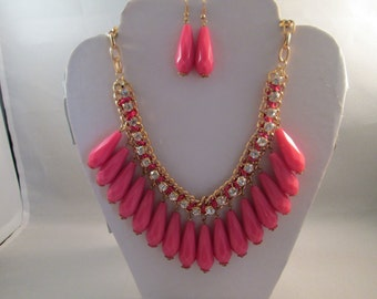 Bib Necklace with Pink Teardrop Beads, Clear Rhinestones and Pin Ribbon on a Gold Tone Chain