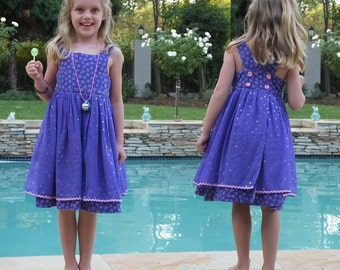 Little Girls Crossover Dress with Voile Apron -  Pattern includes sizes 3 to 8 has 4 Buttons, optional pretty Silk Bow and 2 Pockets.