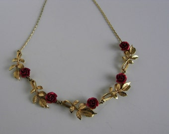 Gold tone red rose bib necklace