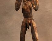 Fine old Asmat figure, Irian Jaya.