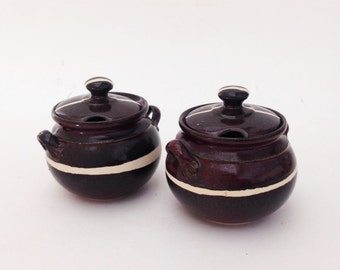 Set of Two Brown Hand Crafted Ceramic Jars with lids
