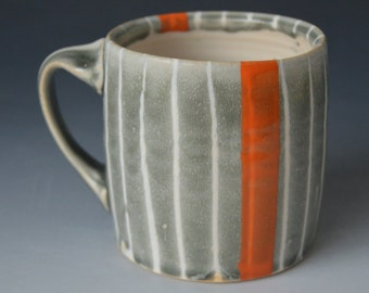 Grey and White Striped Mug with Bold Orange Stripe (E-15)
