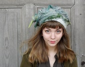 Unique hand-shaped felted hat with tip , shades of gray and green, wool with decorative silk fabric and wool curls, OOAK
